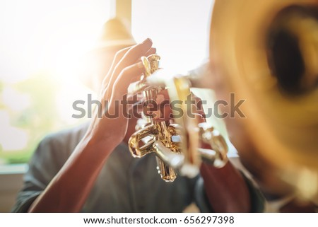 Man playing Trumpet, Saxophonist with Jazz Music instrument #656297398