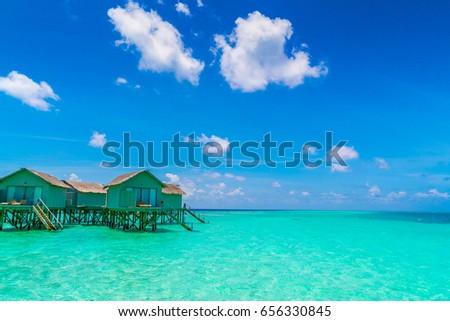 Beautiful water villas in tropical Maldives island #656330845