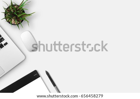 Modern workplace with notebook, little tree, gracphic tablet and graphic pen copy space on gray background. Top view. Flat lay style. #656458279
