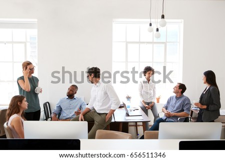 Young business group in discussion in their office Royalty-Free Stock Photo #656511346