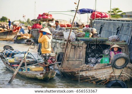 Can Tho, Vietnam - November 15, 2014: Unidentified people on floating market in Mekong river delta. Cai Rang and Cai Be markets are very popular among the local citizens and tourists. #656553367