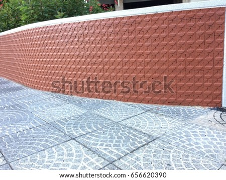 Pavement with floor tiles and wall brick alike #656620390