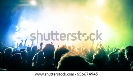 cheering crowd at a rock concert #656674945