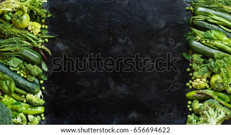 Mix of green vegetables on wooden table top view #656694622