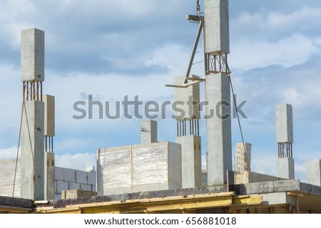 Photo of a house under construction. Building under construction. Lifting cranes and building under construction. big construction site.  #656881018