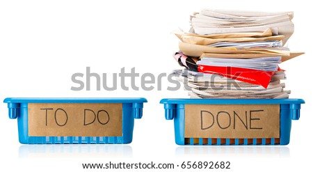 An empty To Do Tray and a full Done tray, Up to Date, Current, On top of things, Productive, Isolated on white background  Royalty-Free Stock Photo #656892682