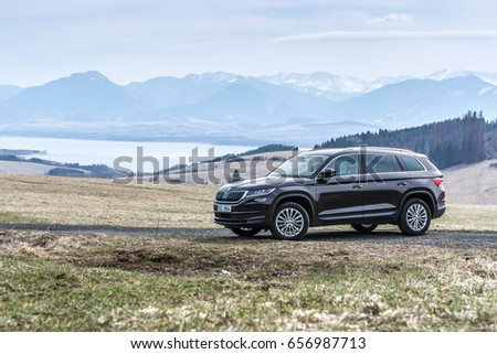 HUTY, THE SLOVAK REPUBLIC, 26. 3. 2017: Skoda Kodiaq 2.0 TDi Style, model year 2017 in Slovakia with view on mountains and lake #656987713