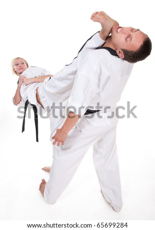 Two people in kimono fight on white background #65699284