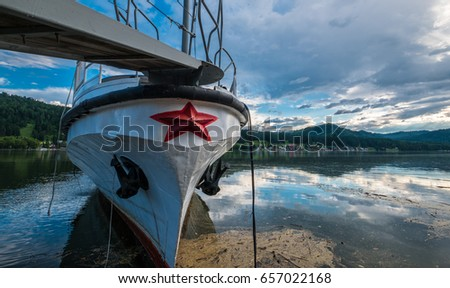 Russian ship of the USSR ,moored near the shore of a mountain lake. Russia #657022168