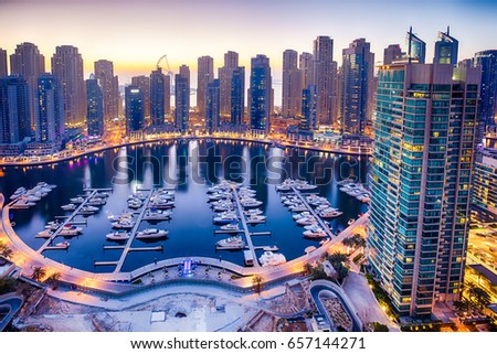 Night view of Dubai Marina taken from where yacht club which is demolished now used to be. Royalty-Free Stock Photo #657144271