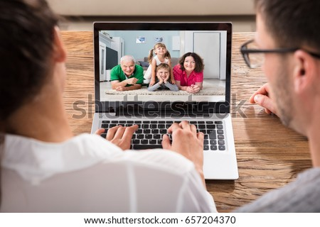 Close-up Of Couple Videoconferencing With Family On Laptop #657204370