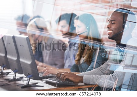 Young Call Center Team Talking With Customers Royalty-Free Stock Photo #657214078