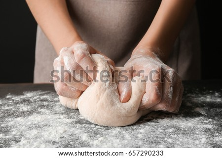 Female hands making dough for pizza #657290233