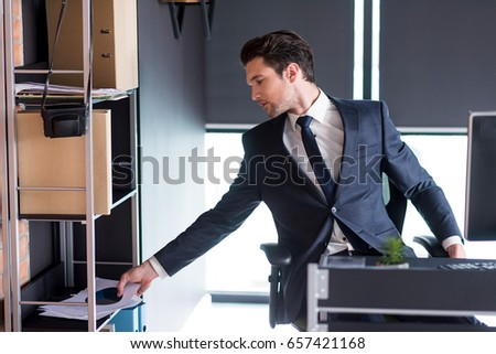 Confident young man is working in office #657421168