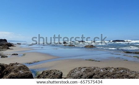 Ocean view with rocks, sand and waves #657575434