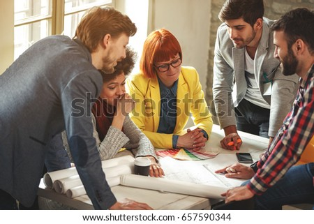 Architects working together - Team of young creative people #657590344