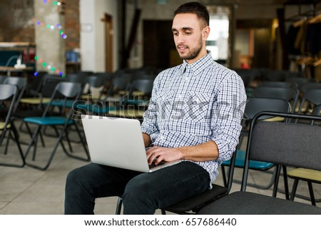 Happy man working  on laptop. Young freelancer. Close up. #657686440
