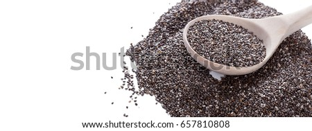 Dry chia seeds in spoon on white background. Closeup #657810808