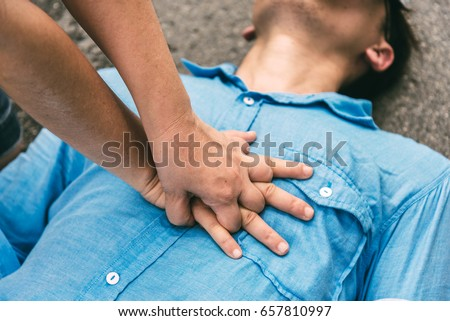 First Aids Emergency CPR on Heart Attack Man , One Part of the Process Resuscitation - Healthcare Concept in Coronavirus Outbreak and Other Situation #657810997