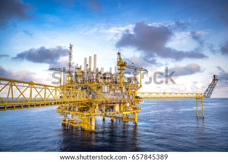 Industrial Offshore oil and gas rig platform with beautiful sky in the gulf of Thailand. #657845389