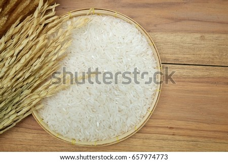 Paddy and white rice on wooden background #657974773