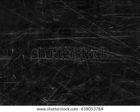 Black old scratched surface, vintage background Royalty-Free Stock Photo #658053784