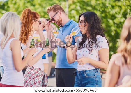Group of friends making a toast, chatting and smiling st the party #658098463