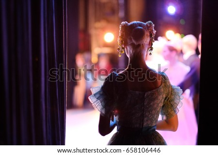 A ballerina awaiting the moment of entering the stage in the play Royalty-Free Stock Photo #658106446