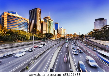 Morning speeding traffic on Warringah freeway going through North Sydney during rush hour. Multi-late highway with bus lane and speed limit flows commuters to their offices. Royalty-Free Stock Photo #658121653
