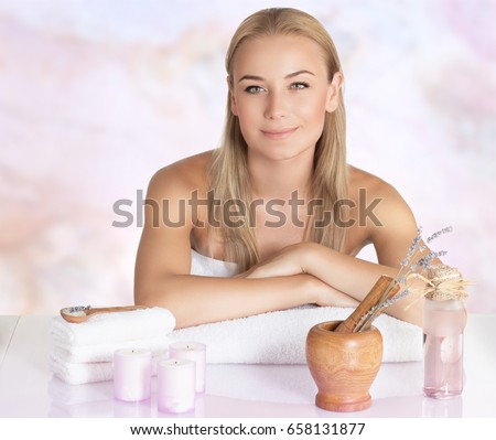 Portrait of a cute blond girl at spa salon, awaiting for a beauty procedure, enjoying time at spa resort, health care and wellbeing concept