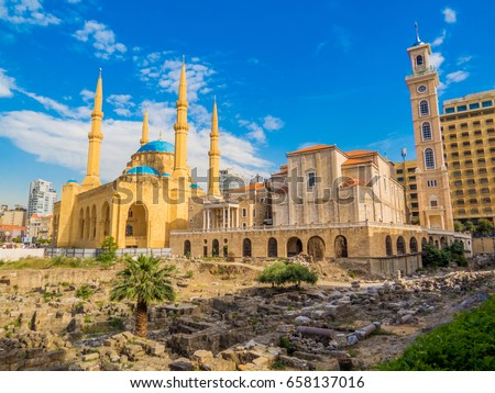 Coexistence of religions in Lebanon - Saint George Maronite Greek Orthodox Cathedral and the Mohammad Al-Amin Mosque Royalty-Free Stock Photo #658137016