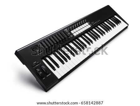 Electronic synthesizer (piano keyboard) isolated on white background with clipping path Royalty-Free Stock Photo #658142887