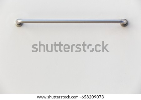 New stainless steel towel holder on grey cement wall in bathroom #658209073