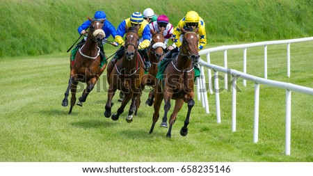galloping race horses in racing competition  #658235146