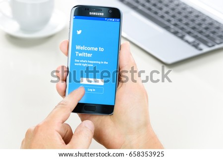 Krynica Poland - June 10, 2017: Samsung Galaxy S7 in the hand when logging into Twitter applications. Twitter is one of the most popular social networking service in the world. #658353925