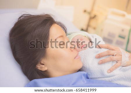 Mother and newborn baby in the hospital. #658411999