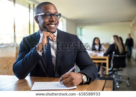 Attentive enthusiastic new hire career worker employee taking notes listening with nice smile #658588933