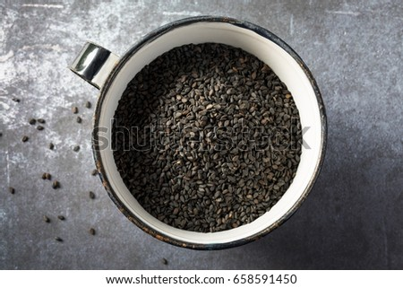 Black Sesame Seeds in a  Cup #658591450