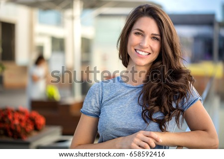 Big bright white smile headshot with a beautiful brunette woman sincere happy cheerful positive expression #658592416