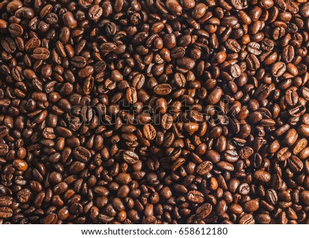 A surface of coffee beans #658612180