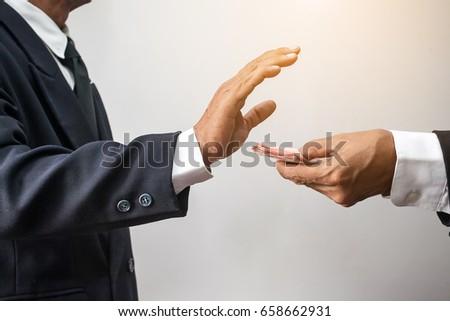 businessman in suit refuses money, corruption concepts #658662931