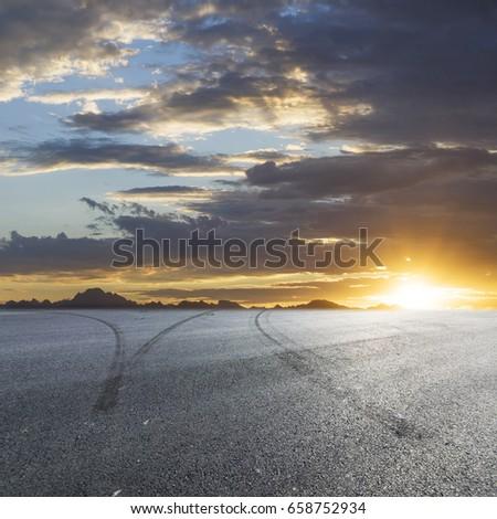 Sunset asphalt asphalt tire marks #658752934