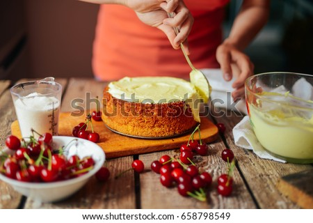 Ingredients for baking cake stuffed with fresh cherry pie. Female preparing cherry pie. Rustic dark style. See series recipe step on step. Womans hands. Recipe for homemade pie on short pastry Royalty-Free Stock Photo #658798549