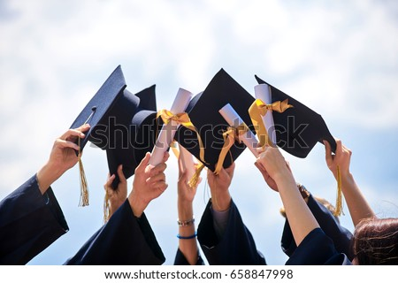 Graduation Caps Thrown in the Air        Royalty-Free Stock Photo #658847998