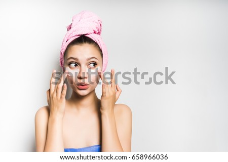 Surprised face woman touch patches under eyes,isolated.Beauty sk