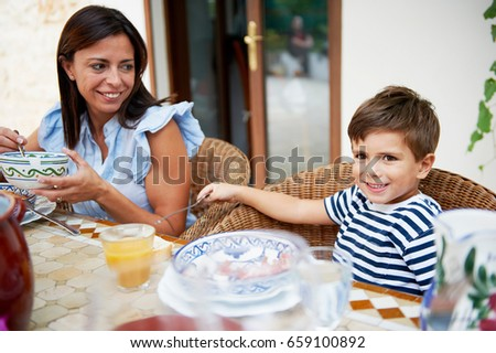 Mother and son having lunch #659100892