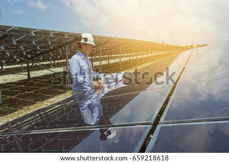 Engineer checking at solar power station. #659218618