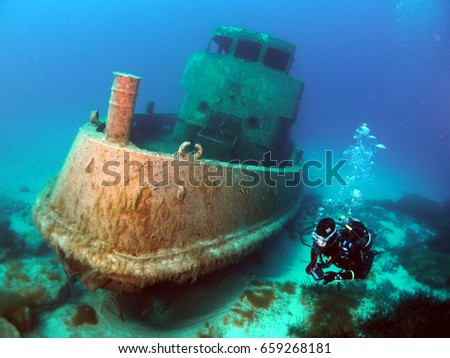 Diving the new location of the Tug2 Wreck - Exiles Beach , Sliema , Malta #659268181