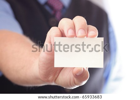 Businessman showing business card - focus on fingers and card. You can just add your text there. #65933683