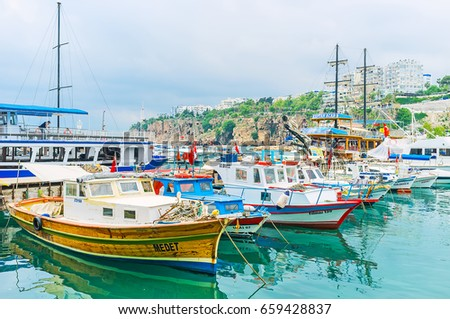 ANTALYA, TURKEY - MAY 6, 2017: The old marina is the perfect place to choose the boat for the fishing trip, on May 6 in Antalya. #659428837